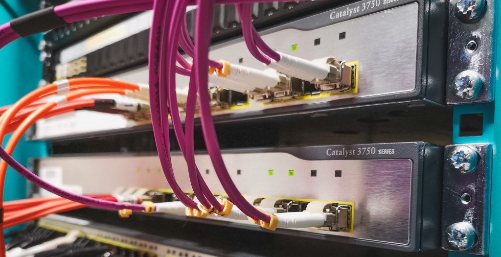 Cisco 3750 switches provide fibre connectivity with purple and orange patch cables. Are these old switches ready for an infrastructure upgrade?